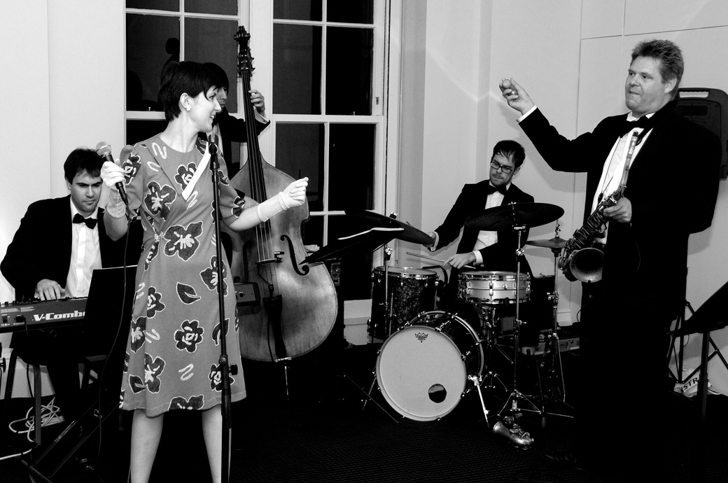 The band in full flow in this wedding photograph captured at a reception in the David Lean Room at iconic London wedding venue BAFTA, 195 Piccadilly