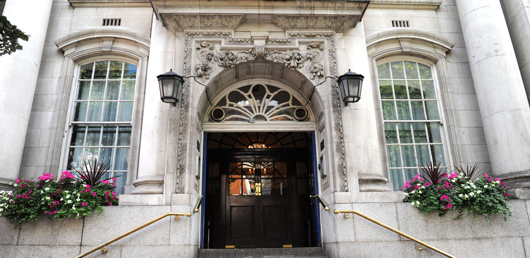 The ornate doorway at the top of the steps of the classic London wedding venue Chelsea Register Office located in the Chelsea Old Town Hall on the famous Kings Road