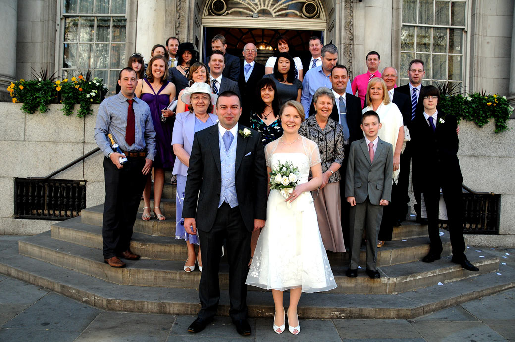 On the steps of the Chelsea Old Town Hall in the Kings' Road after a wedding at the famous London venue Chelsea Register Office for the everyone group wedding photograph