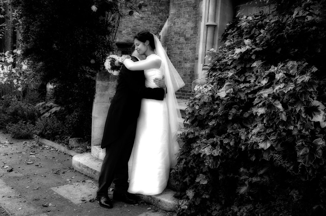 A gentle loving private moment wedding photo captured by London lane wedding photography at the London Brompton Oratory