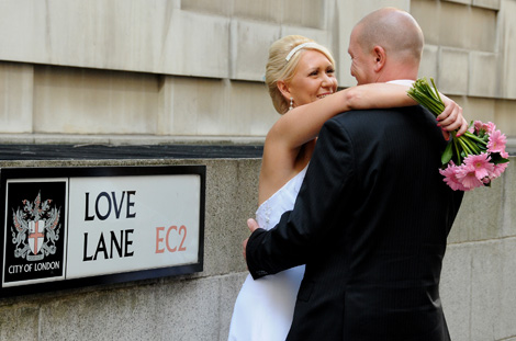 Newlyweds embrace in this romantic wedding picture taken in Love Lane in the City opposite The Cape Bar an alternative London wedding venue