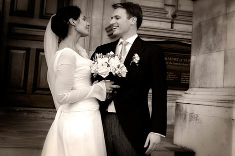 A lovely romantic Bride and Groom wedding photograph taken on the steps of the Brompton Oratory in Kensington London after a marriage at the Little Brompton Oratory