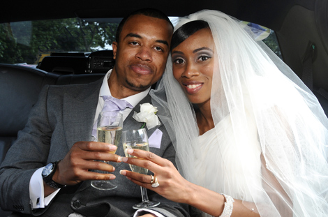 Celebratory drinks in the back of the bridal car for this lovely couple in this wedding picture taken in South London outside Merton Register Office Morden Park