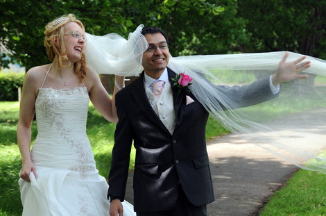 Lots of laughter as the Groom gets caught up in the Bride's blowing veil in this fun wedding picture taken at Merton Register Office Morden Park House in London