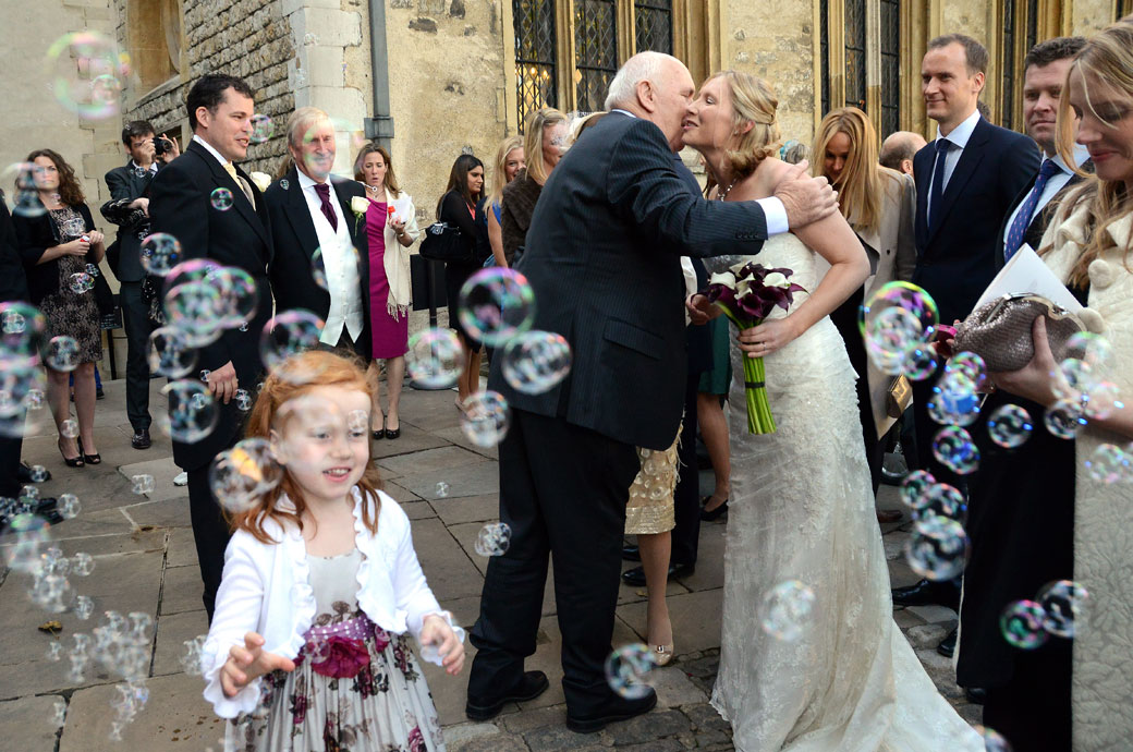 Hugs And Kisses Amongst The Bubbles Wedding Photograph Captured At Tower Of London Outside