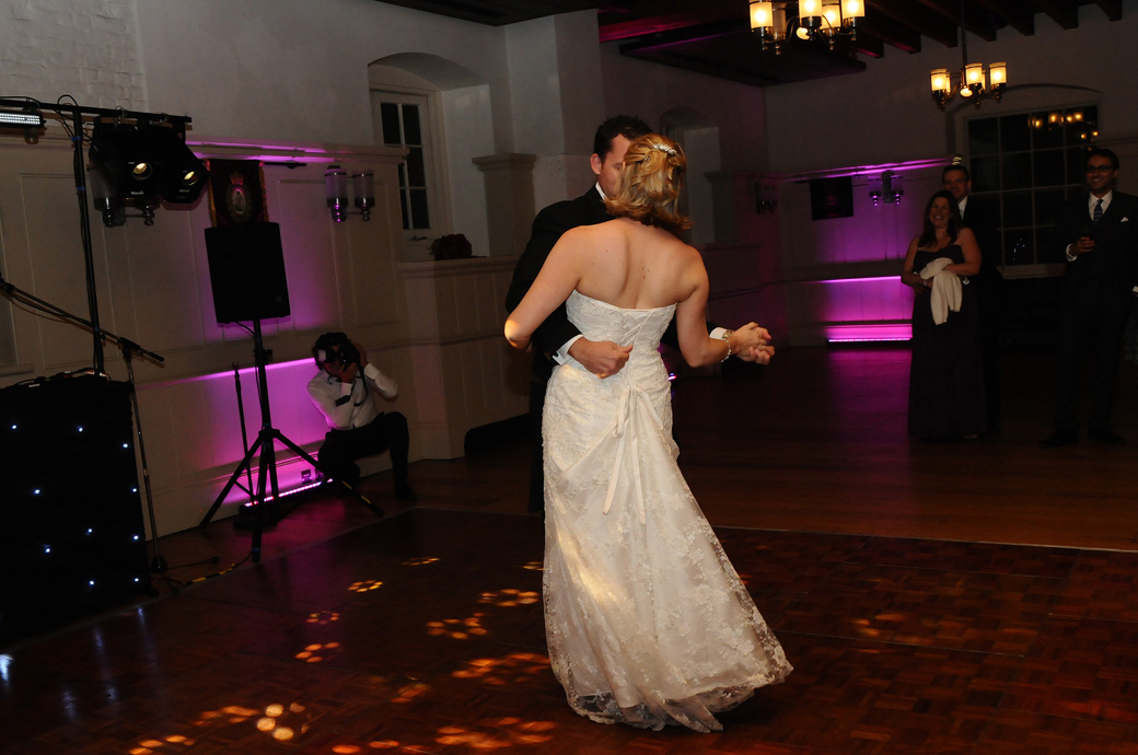 Romantic first dance wedding picture captured under the disco lights in the New Armoury Banqueting Hall at The Tower of London wedding venue