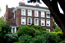 The beautiful genteel Grade l listed 18th Century Burgh House with its light and airy wooden panelled Music Room makes it a fine London wedding venue in Hampstead