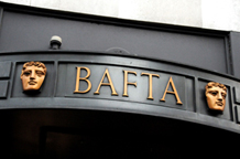 A wedding picture taken of the iconic BAFTA masks positioned over the main entrance door of the unique thetrical London