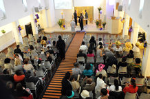 The modern red bricked building that is Clapham Methodist Church has a bright white interior and was  rebuilt in 1961 after bomb damage and recently extended London wedding venue