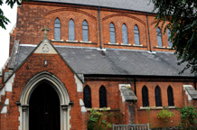 St. Thomas with St. Stephen's Church in Balham is a large welcoming red brick London wedding venue situated in a residential road and a short walk from Tooting Bec Common