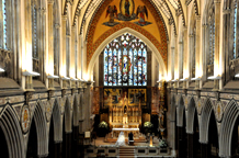 A wedding photo of the interior of the stunning gothic–style Grade ll listed  London wedding venue The Church of Immaculate Conception in Farm Street Mayfair