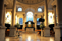 The beautiful interior of Sir Christopher Wren's masterpiece church St Stephens Walbrook a unique London wedding venue in the city complete with a Henry Moore stone altar sculpture